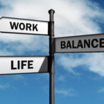 Work-life balance road sign concept for healthy lifestyle and wellbeing choice